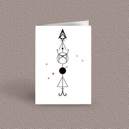 Aries represented as a geometric design arrow on a greetings card