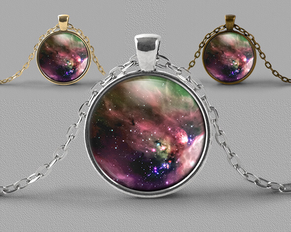 Astrology jewellery pendant necklace nebula of soft pinks and greens with scattering of stars