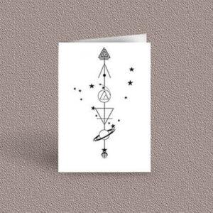Capricorn represented as a geometric design arrow on a greetings card