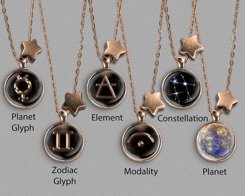 A range of Gemini zodiac designs set in silver coloured pendants