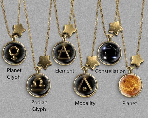 A range of Libra zodiac designs set in gold coloured pendants