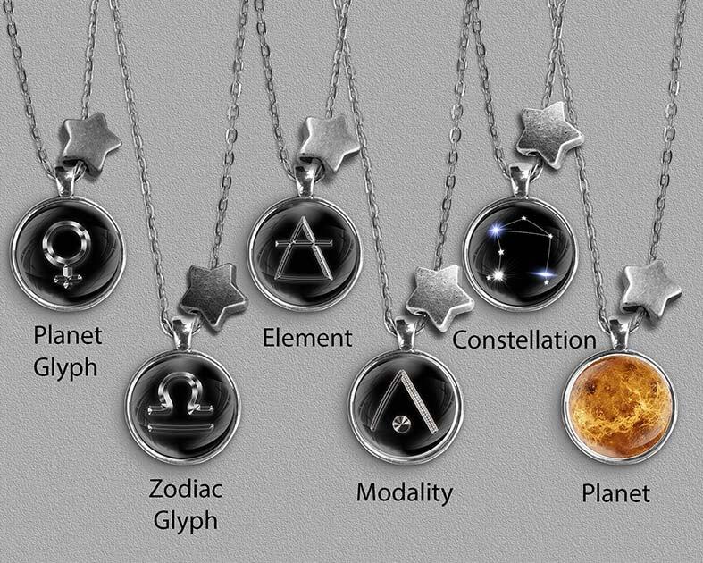 A range of Libra zodiac designs set in silver coloured pendants