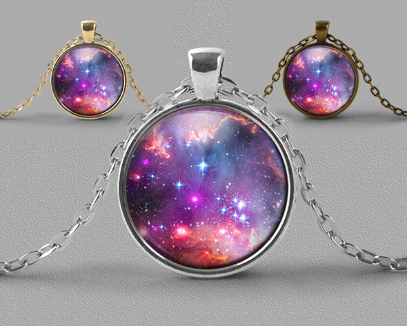 Astrology jewellery pendant necklace of nebula in soft pinks and lilac with a scattering of stars