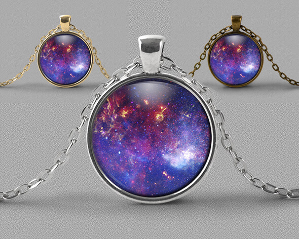 Astrology jewellery pendant necklace of nebula in shades of violet and red with gold flecks