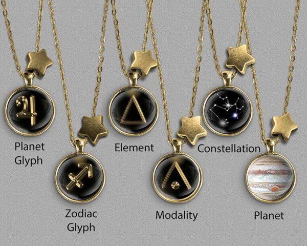 A range of Sagittarius zodiac designs set in gold coloured pendants