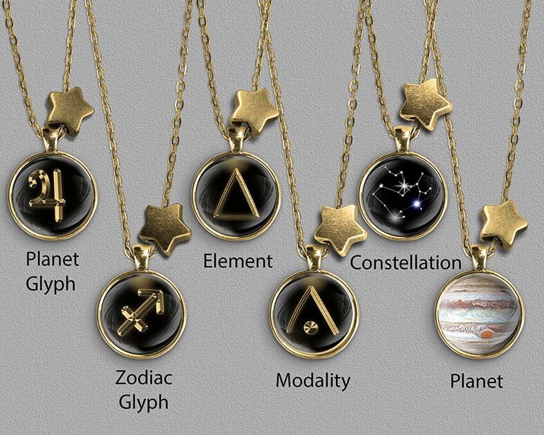 A range of Sagittarius zodiac designs set in gold coloured pendants
