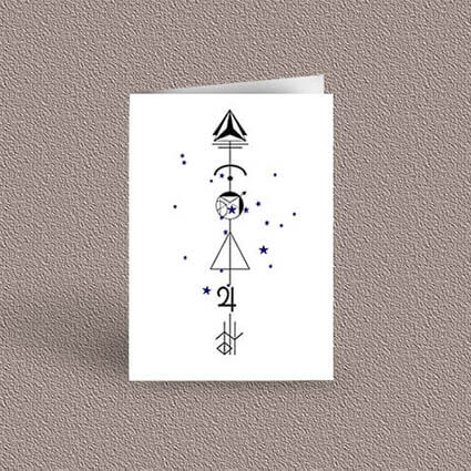 Sagittarius represented as a geometric design arrow on a greetings card