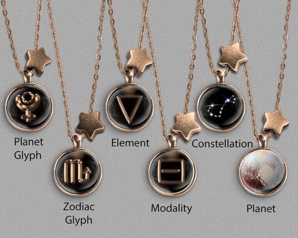A range of Scorpio zodiac designs set in bronze coloured pendants