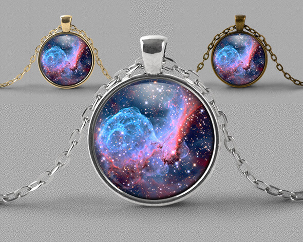 Astrology jewellery pendant necklace of beautiful pink and blue nebula with scattering of stars