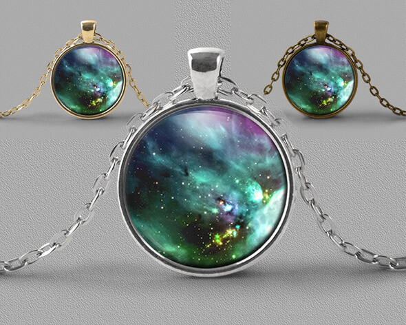 Astrology jewellery pendant necklace of nebula in shades of green teal and blue
