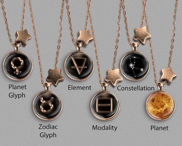 A range of Taurus zodiac designs set in bronze coloured pendants